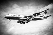 Airplane Photo Posters - United Airlines Boeing 747 Airplane Black and White Poster by Paul Velgos