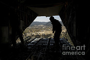Pallet Framed Prints - U.s. Air Force Airman Pushes Framed Print by Stocktrek Images