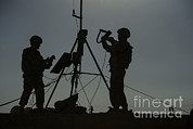Backlit Photo Prints - U.s. Air Force Members Conduct An Print by Stocktrek Images