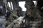 Helping Prints - U.s. Army Flight Medics Aid A Simulated Print by Stocktrek Images