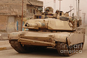 Us Army Tank Posters - U.s. Army M1 Abrams Tank Conducts Poster by Stocktrek Images