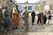 People. Talking Posters - U.s. Army Soldier And An Afghan Uniform Poster by Stocktrek Images
