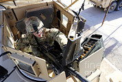 Up-armored Framed Prints - U.s. Army Soldier Checks A Mk-19 Framed Print by Stocktrek Images