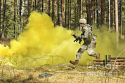 Featured Art - U.s. Army Soldier Moves Through An by Stocktrek Images