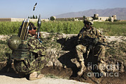 Afghan Framed Prints - U.s. Army Soldier Takes A Break With An Framed Print by Stocktrek Images