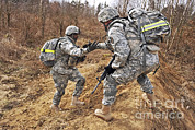 Helping Prints - U.s. Army Soldiers Helps A Fellow Print by Stocktrek Images