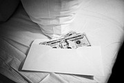 Cash Money Prints - us dollars cash left in an envelope by the side of the bed in a hotel room in Las Vegas Nevada USA Print by Joe Fox