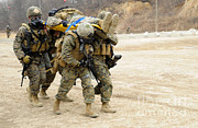 Featured Art - U.s. Marines Carry A Fellow Marine by Stocktrek Images