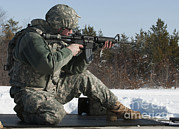 Mccoy Posters - U.s. Soldier Fires His M4a3 Carbine Poster by Stocktrek Images