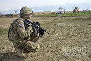U.s. Soldier Patrols A Village Print by Stocktrek Images