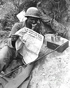 War Photography Prints - U.s. Soldier Reads The Latest News Print by Stocktrek Images