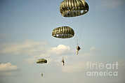 Eglin Framed Prints - U.s. Soldiers Descend Through The Sky Framed Print by Stocktrek Images