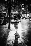 Busstop Prints - Vancouver city bus at stop on wet street in early evening in downtown city centre BC Canada Print by Joe Fox