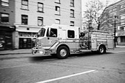 Speeding Truck Framed Prints - Vancouver fire rescue services truck engine 2 speeding through downtown city streets BC Canada delib Framed Print by Joe Fox