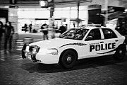 Patrol Car Framed Prints - Vancouver police squad patrol car vehicle BC Canada deliberate motion blur Framed Print by Joe Fox