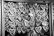 Christmas Market Prints - various Lebkuchen hearts hang for sale from a stall in the christmas market Berlin Germany Print by Joe Fox