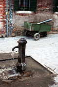 Old Water Pump Prints Prints - Venetian Water Pump Print by John Rizzuto