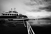 Passenger Ferry Prints - vengsoy passenger ferry Tromso harbour quay and bridge on a cold winter day troms Norway europe Print by Joe Fox