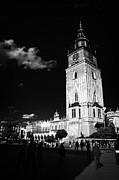 Polish City Framed Prints - vertical The 13th century  Gothic town hall tower with tourists in rynek glowny town square krakow Framed Print by Joe Fox