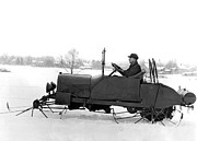 Wintry Photo Prints - Very Early Snowmobile Print by Underwood Archives