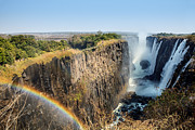 Zambia Waterfall Framed Prints - Victoria Falls with rainbow Framed Print by Ignatius Tan