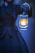 Hurricane Lamp Prints - Victorian Or Edwardian Woman Holding An Oil Lamp At Night Print by Lee Avison