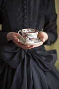 Satin Dress Prints - Victorian Woman Holding A China Cup And Saucer Of Tea Print by Lee Avison