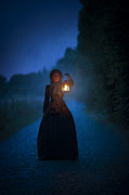 Oil Lamp Photos - Victorian Woman Holding A Lantern At Night by Lee Avison