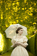 Dappled Light Photos - Victorian Woman Holding A Parasol In A Summer Garden by Lee Avison