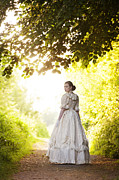 Dappled Light Photos - Victorian Woman On A Woodland Path by Lee Avison