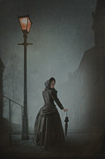 Foggy Street Scene Acrylic Prints - Victorian Woman Under Streetlamp In Fog Acrylic Print by Lee Avison