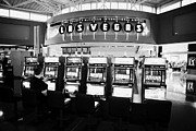 Video Gaming Framed Prints - video poker gaming gambling machines in mccarran international airport Las Vegas Nevada USA Framed Print by Joe Fox