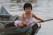 Floating Girl Posters - Vietnamese Girl on Lake Tonle Sap Poster by Vivian Christopher