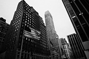 Manhaten Prints - view of pennsylvania bldg nelson tower and US flags flying on 34th street from 1 penn plaza nyc Print by Joe Fox