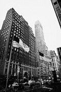 Manhaten Prints - view of pennsylvania bldg nelson tower and US flags flying on 34th street new york city Print by Joe Fox