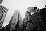 Manhaten Prints - view of US flag flying on 34th street from 1 penn plaza new york city usa Print by Joe Fox
