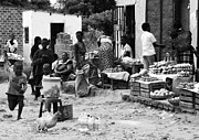 Women Children Photo Prints - Village Life Print by Aidan Moran