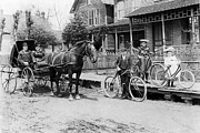 Horse And Buggy Framed Prints - Village Street Scene Framed Print by Underwood Archives