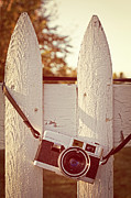 Camera Posters - Vintage film camera on picket fence Poster by Edward Fielding