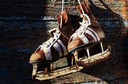 Antique Skates Prints - Vintage Pair Of Mens  Ice Skates Hanging On A Wooden Wall With C Print by Mikhail Olykaynen