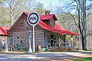 Log Cabins Prints - Vintage Store and Pure Oil Sign Print by Kenny Francis