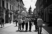 Polish City Prints - Visitors Walking Down The Ulica Florianska Street Leading Down From City Gates To Old Town City Centre Krakow Print by Joe Fox