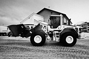 Gravel Road Prints - volvo wheel loader carrying grit and stones for icy road use Honningsvag finnmark norway europe  Print by Joe Fox
