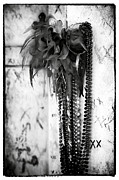 Headstones Metal Prints - Voodoo in New Orleans Metal Print by John Rizzuto