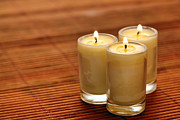 Trio Photo Prints - Votive Candle Burning Print by Olivier Le Queinec