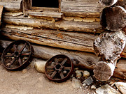 Old Log Cabin Photographs Photos - Wagon Wheels by Alan Socolik