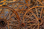 Wagon Wheels Photos - Wagon Wheels On Mill Wall by Scott Gall
