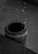 Pipe Photos - Water Dripping Up The Spout by Bob Orsillo