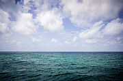 Color Green Photo Posters - Water Horizon with Clouds and Blue Sky Poster by Paul Velgos
