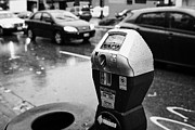Coins Framed Prints - water soaked coin and credit card parking meter on the streets of downtown Vancouver BC Canada Framed Print by Joe Fox